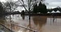 River Severn braking its riverbanks and flooding car parks and footpaths in Stourport